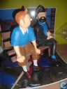 Tintin and Captain Haddock on a couch