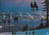 Skier's night view of the city from top of grouse mountain