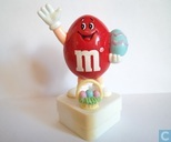 Red M&M with Easter egg and basket