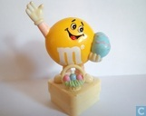 Yellow M&M with Easter egg and basket