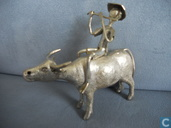 thumbnail: flute player, sitting on a Buffalo