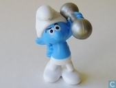 Burly Smurf with dumb-bell