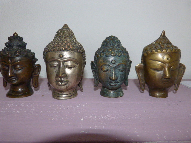 Four bronze Buddha heads-Thailand-second half 20th century.