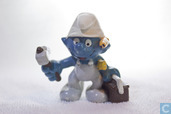 Handyman Smurf with hammer and toolbox