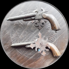couple two barrel pinfire pistols transformed to wall light points -19th century.