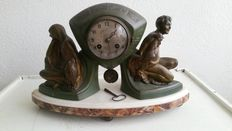 P. Sega - Art Deco mantle clock in patinated metal casing