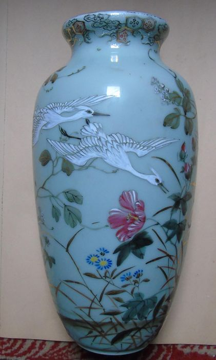 Ancient Japanese Ceramic Vase With Egret Motif On A Green Background