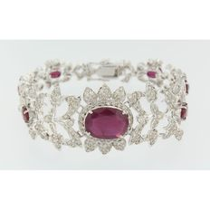 White gold bracelet in art deco style with oval cut ruby and many brilliant cut diamonds