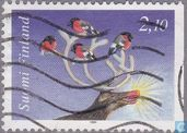 Bullfinches in the antlers of a reindeer