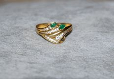 Gold ring with emerald and diamonds.