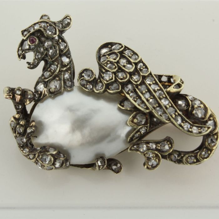 "Victorian gold with silver brooch, ""a flying dragon"" with many rose cut diamonds, mother of pearl and ruby"