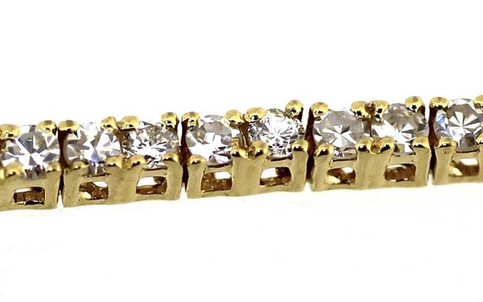 Rivière bracelet 18K yellow gold set with white diamonds