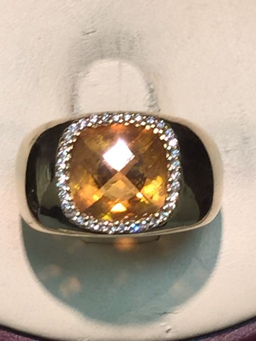 Yellow golden entourage ring set with citrine and diamonds total 3.538 ct.