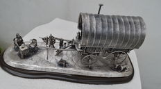 Large silver sculpture on wooden base, gypsy family with covered wagon, Edinburgh, 2014