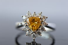 Heart shaped diamond entourage ring with Fancy Intense Yellow Orange diamond, 1.50 carat