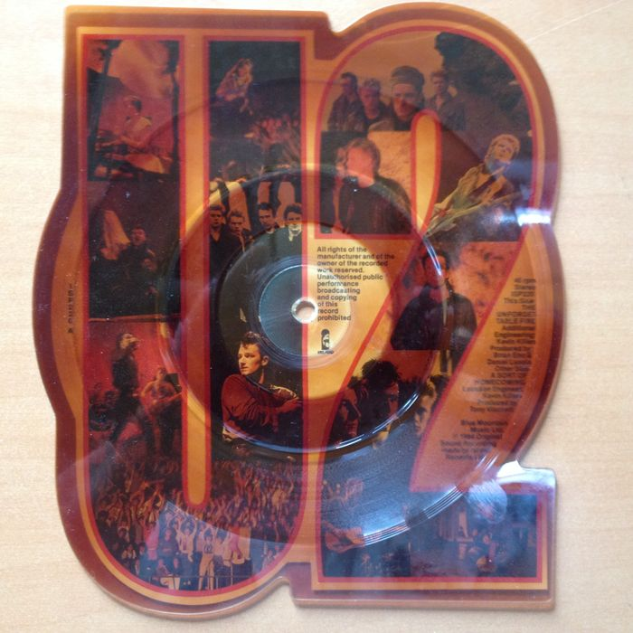 "U2 - Rare Withdrawn Mispress  45 RPM / 7"" Shaped Picture Disc  ""Unforgetabletable Fire / Sort Of Homecoming"""
