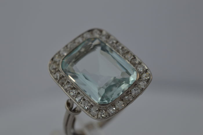 Platinum entourage ring with aquamarine and diamonds