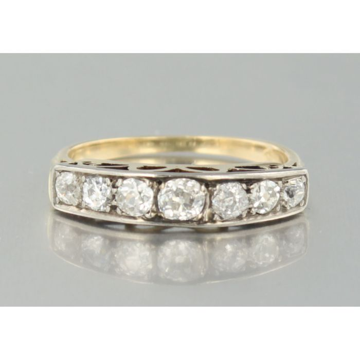 Bicolored row ring with Bolshevik cut diamonds