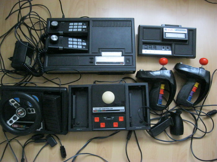 Colecovision with Racing wheel, Superaction controllers, Roller controller  and a lot of 44 games - Catawiki