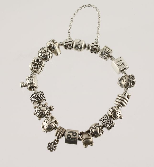 Silver Pandora bracelet with security chain and 17 charms of i.a. horse e11f16f8c