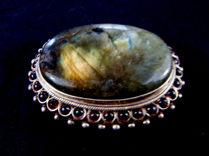 Sterling silver belt buckle set with a large labradorite