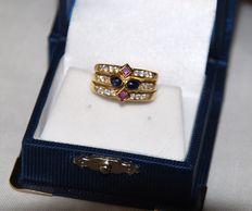 18 kt Gold ring, 2 Sapphires, 2 Amethysts and 22 diamonds. 18 mm.