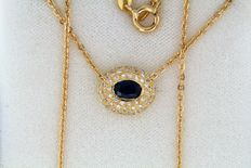 Pendant + 18 kt yellow gold chain + sapphire + diamonds - Chain length: 41 cm.