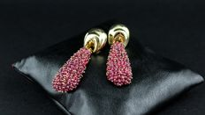 Gold and ruby dangle earrings.