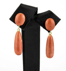 Yellow gold earrings with natural Pacific coral in oval and pear shape.