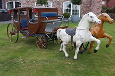 Unique carriage with couple of horses from fairground carousel