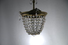 A cut-glass and brass chandelier, first half 20th century