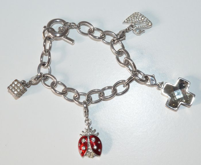 45210fe9b943 Swarovski - Charm bracelet with 4 charms - Catawiki