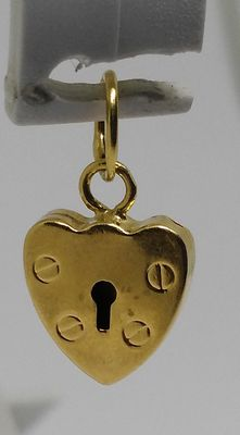 Small women's lock pendant in 18 kt yellow gold