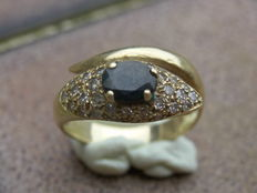 Ring with Blue Sapphire and Diamond Pieces.