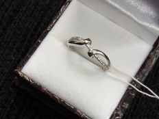 Engagement golden ring with diamonds