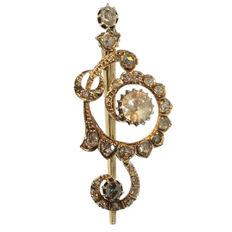 Musical Antique 'Sol Key' shaped gold brooch finished with rose cut diamonds, anno 1910