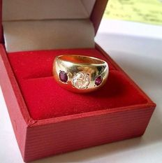 Gold ring with a diamond 0.65 ct and 2 rubies