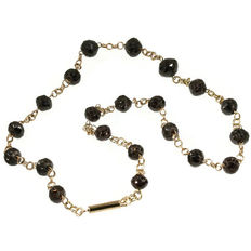 Victorian red gold double rolo chain alternated with faceted garnet beads and gold closure