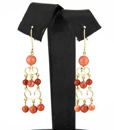Long dangle yellow gold earrings with natural Pacific coral gemstones