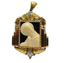 Gold 18 kt Art Deco pendant with antique cut diamonds and a bone carving on a black background, 1930s