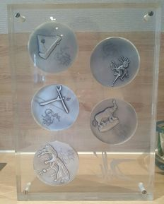 Salvador Dali for Diners Club - Ten silver tokens with relief decorations depicting the Ten Commandments