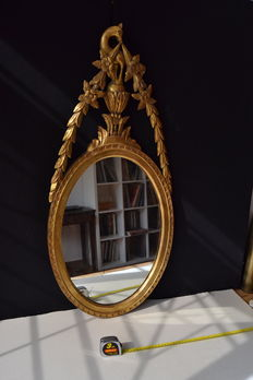 An attractive Adam style giltwood oval mirror - with a bird and flower carved cresting - 19th century
