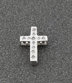 White gold cross, set with 11 diamonds.