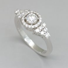 White gold ring with 0.79 ct of brilliant cut F - G / Fine White diamonds, central 0.40 ct. F / VS1 diamond