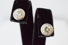 White gold, solitaire earrings with large brilliants of 1.70 ct.