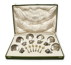 18-piece set of silver coffee cups made by  M. ESPUÑES Y CIA., Madrid.