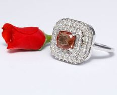 Gold ring with 5.07 ct diamonds and orange sapphire ring in 14 kt hallmarked white gold.