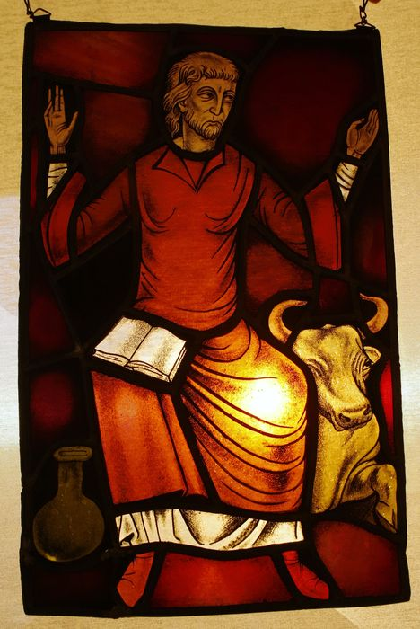 Stained Glass Evangelist Luke With The Symbol Ox And The Book Luke