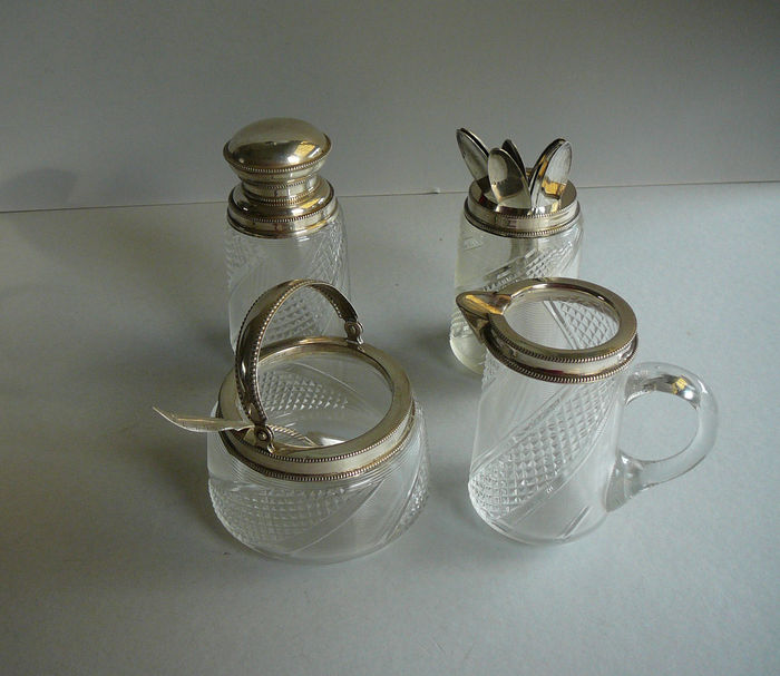 Extensive cream set with silver mountings and spoons, Netherlands, 1872 and later
