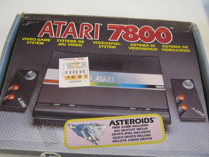 Atari 7800 console, complete in box with 2 controllers, cables and game Asteroids